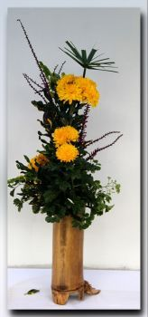 Yellow Mums in a Bamboo Vase