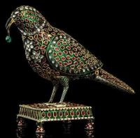 An emerald, ruby and diamond-inset enameled gold parrot from India,