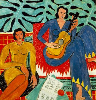 Two women with a guitar