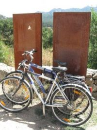 Two old bikes & two rusty tourist info boards