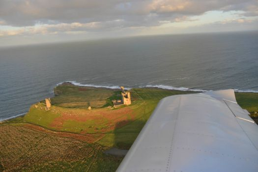 Dunstanburgh Castle Northumberland.....almost beneath the wing.