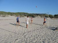 Beach volley on the warm sands of Rena Majore, Sardinia