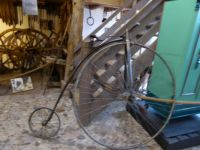 The old times Museum Aalten.  A Velopedy, with one big front wheel and a tiny back wheel.
