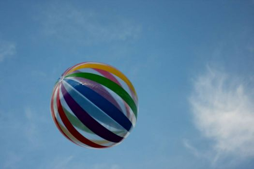 Beach Ball in the Blue Sky