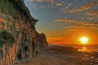 Sunset at Murawai Beach, NZ