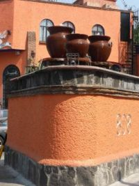 MEXICO - Mexico City - Morning Walk in Coyoacan - House decorated with jarros (pottery)