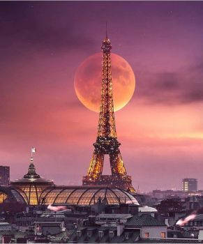 Super moon behind Eiffel Tower