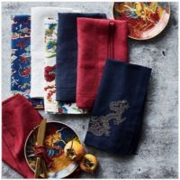 Table linens and 2 persimmons