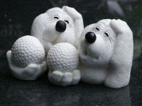 Dogs with a golf ball