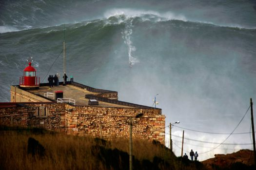 Garrett McNamara rides a 100-ft wave off Praia do Norte beach in Nazare, Portugal