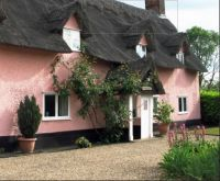 The Pink Thatched Cottage. Suffolk.