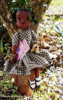 Black Doll Collecting: Meet Kizzy, She is Sitting Under A Tree With Her Toys And Books,  By Kor January