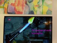 Svat (Safed): the glass blower demonstrated her work - with the assistance of a TV camera providing a close-up of the work in progress