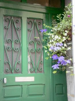 Clematis at the door, village of La Ferte Mace, France