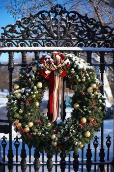 Christmas wreath on an iron fence