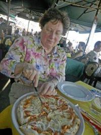 27.  Kay with a Venetian pizza, Italy 2011