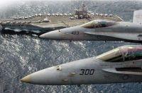 Two FA18 Hornets Fly Above USS Ronald Reagan CVN 76
