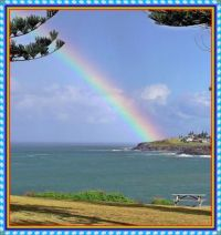 Rainbow over the headland at Kiama.