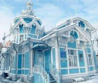 Blue + White Victorian House in winter