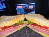 Ham, mortadella, mayo, salami, tomato, lettuce, extra sharp good Vermont cheddar cheese, butter, lightly toasted white bread