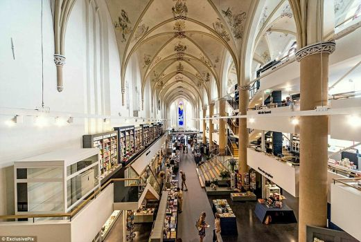 15th Century cathedral in Swolle, Netherlands transformed into a modern bookshop