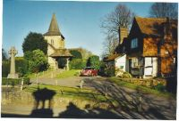 Ewhurst Church and 'The Old Post Office', Ewhurst, Surrey.  Photo by Colin Smith