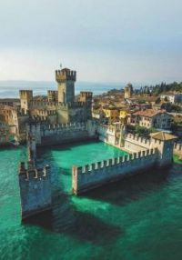 "Castello Scaligero (the ""sinking castle"") in Sirmione, Italy"
