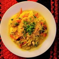 Thai yellow curry spaghetti squash with chicken and crushed peanuts