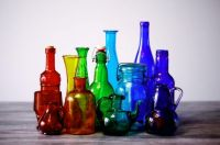 Colorful old glass bottles and vases