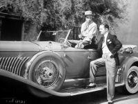 William Powell admires Gary Coopers Duesenberg