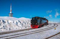 train against bright blue sky.