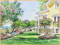 yellow cottage and flower garden
