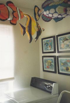 For RobbieL - 1 of the 10 x 10 bedrooms became a laundry with swimming FISH pillows!