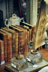 Old books and quill pen