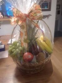 A birthday fruit basket from a friend.  There is so much fruit in here, I am sharing with the neighbors.  Yummy.