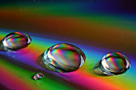 waterdrops on a rainbow-coloured ground