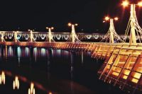 Lighted bridge over the river and pier
