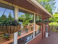 3 - hanging baskets for the deck - and their reflection in fhe windows, May 2021