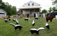Theme: Lawn Trash - Handmade Skunks and Others.