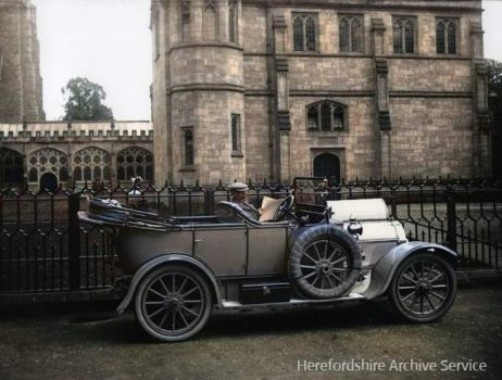G36-012-04 Man in motor car outside Hereford Cathedral, 1912