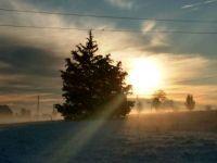 Sunrise over the snow-clad farm