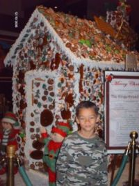 A Real big Gingerbread House and my son. Inn of the Mountain Gods in Ruiodoso N.M.