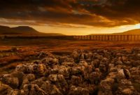 Sun is setting over Ribble Valley and Ribblehead Viaduct (Batty Moss Viaduct) in North Yorkshire, England