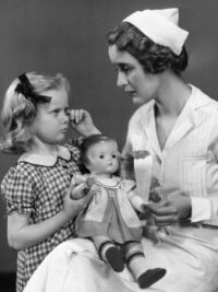 Vintage Photo: Nurse Consoling Young Girl and Her Patsy Doll
