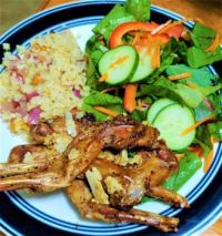 Garlic parmesan bunny wings (front legs), salad from my garden, cauliflower rice with red onion and foraged chanterelles