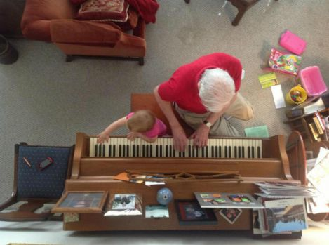 Evie making music with her great grandfather, Luke