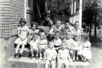 Fourteen cousins on the front steps of their grandparents' home, 1956