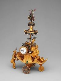 "Automaton in the form of a chariot pushed by a Chinese attendant and set with a clock"" British, London 1766 C.E."