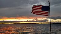 Flag at Stormy Sunset