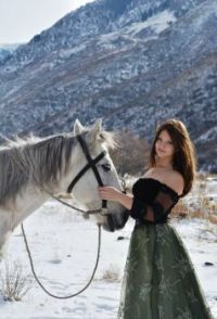 Pretty girl with a horse